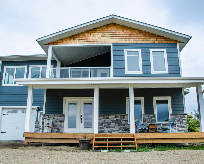 Two storey house with blue siding